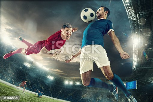 istock Two men are playing soccer and they compete with each other 951968352