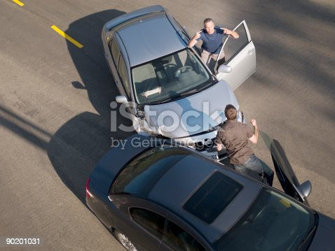 istock Two men arguing about damage in car collision 90201031