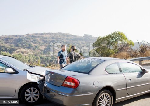 1047083324 istock photo Two men arguing about damaged cars 90201066