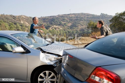 istock Two men arguing about damaged cars 90201068