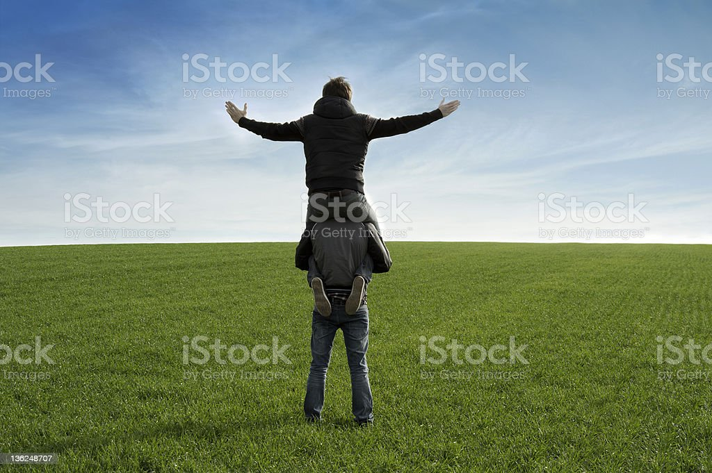 Two men at the grass stock photo