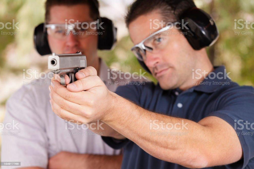 Two Men at the Shooting Range stock photo