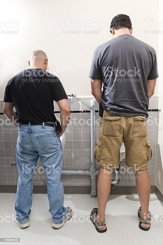 Two Men at the Urinals stock photo
