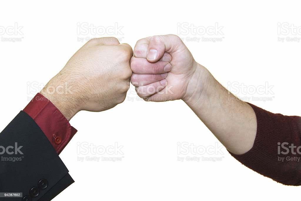 Two men bringing fists together royalty-free stock photo