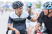 Two men chat before bike race for charity