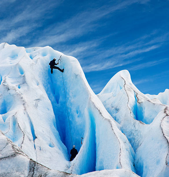 Two men climbing a glacier in patagonia, Argentina.