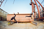 Two men doing free running parkour