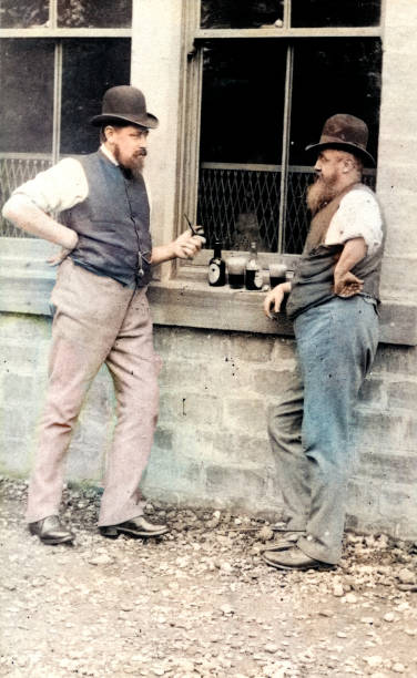 Two men drinking beer after a hard days work, Victorian stock photo