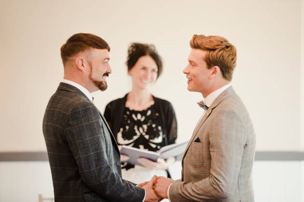 Two Men Exchanging Vows On Their Wedding Day stock photo