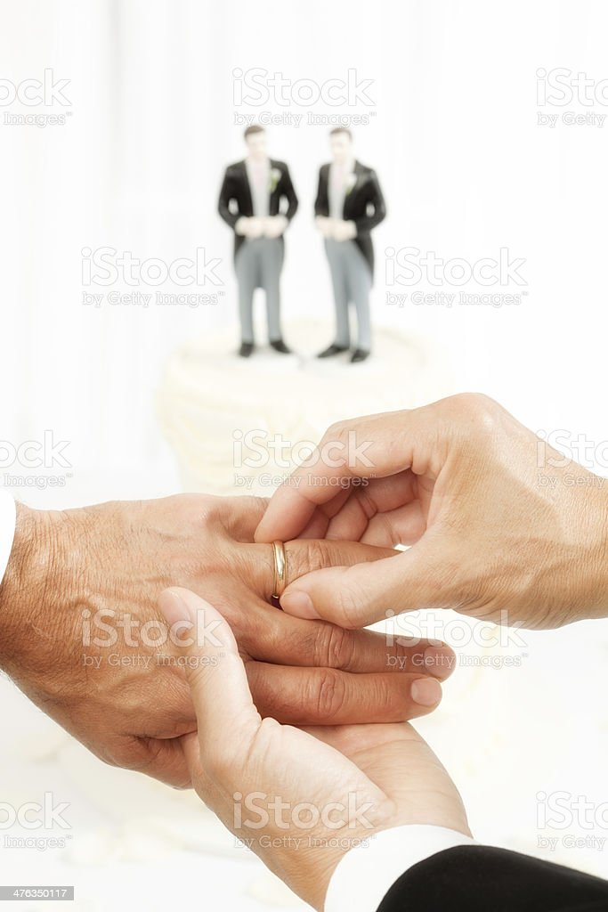 Two Men Exchanging Wedding Ring in Same Sex Marriage_ royalty-free stock photo