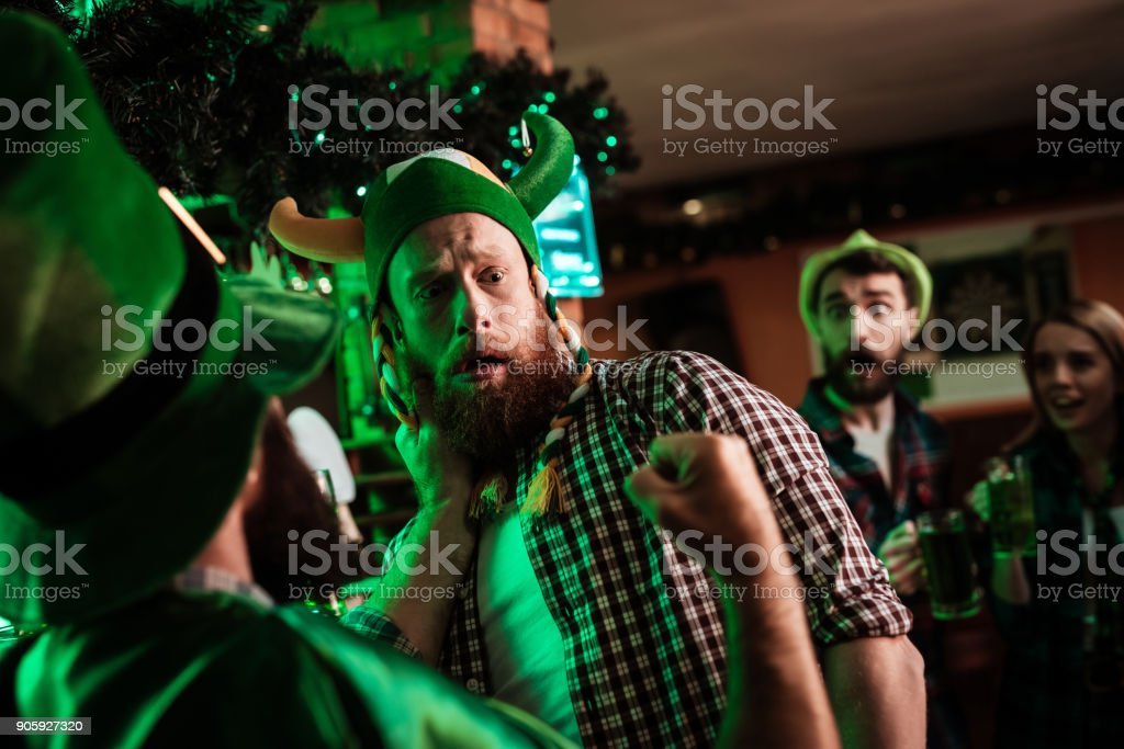 Two men fight in a bar. stock photo