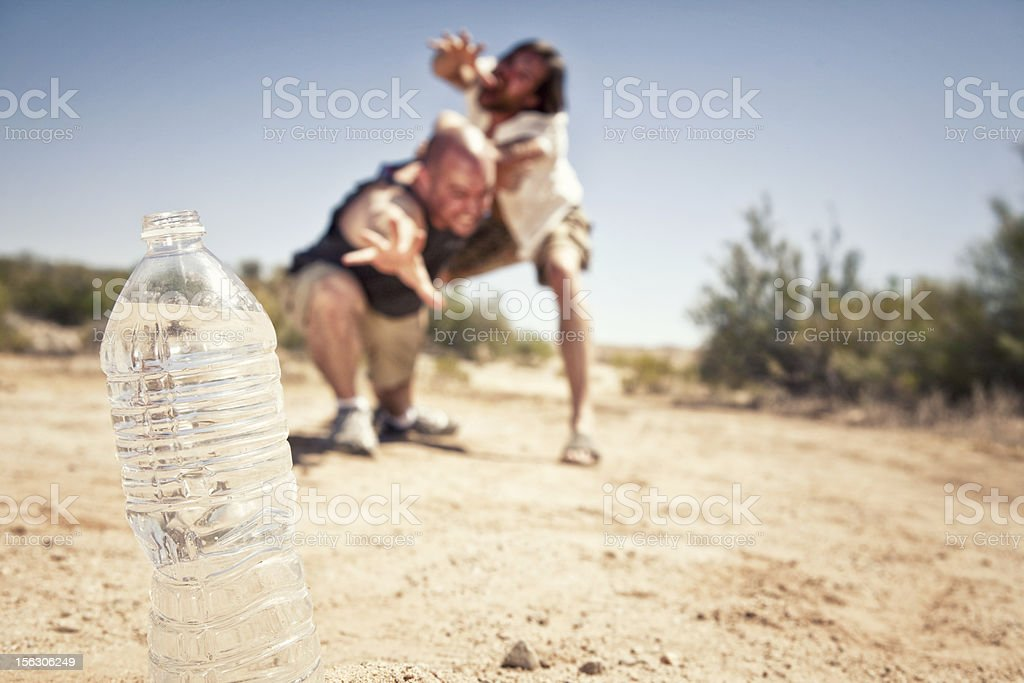 Two Men Fighting Over Water royalty-free stock photo