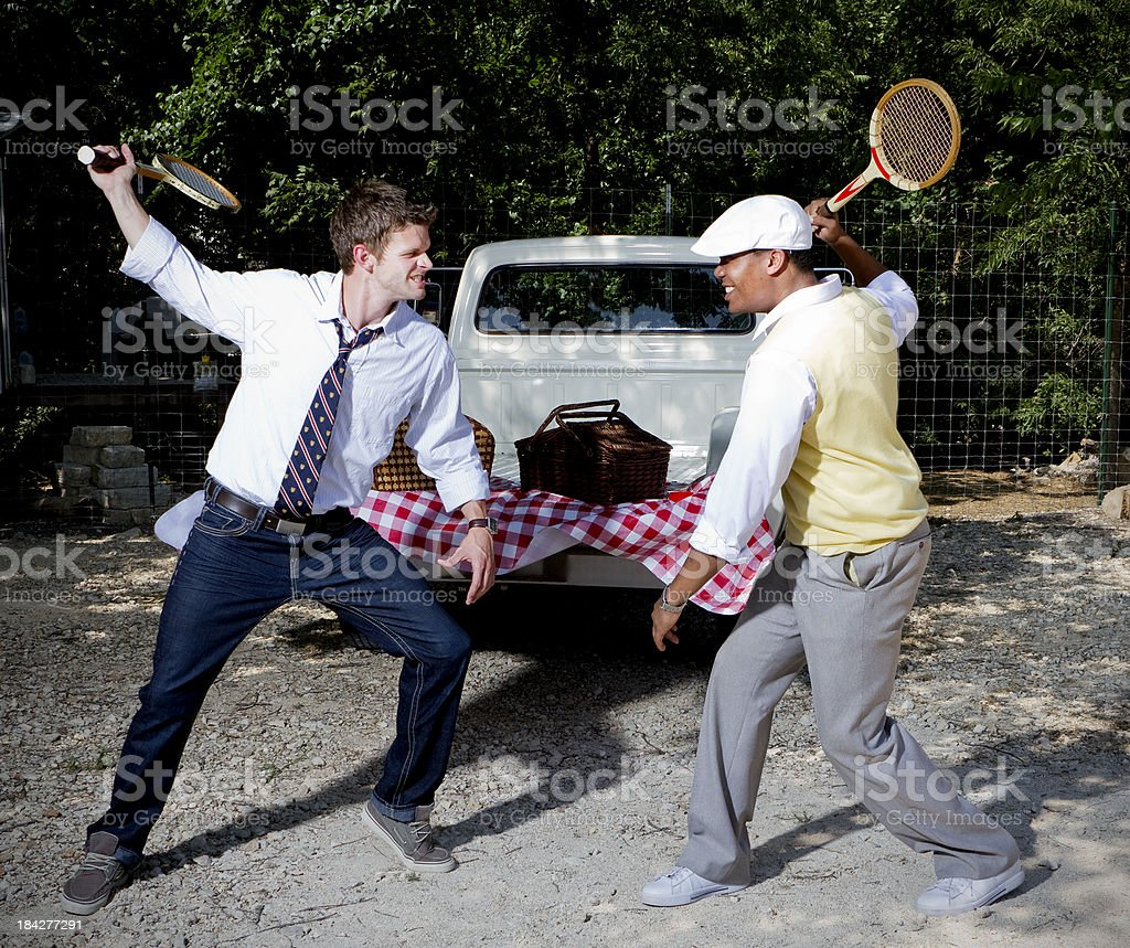 Two Men Fighting with Tennis Rackets royalty-free stock photo