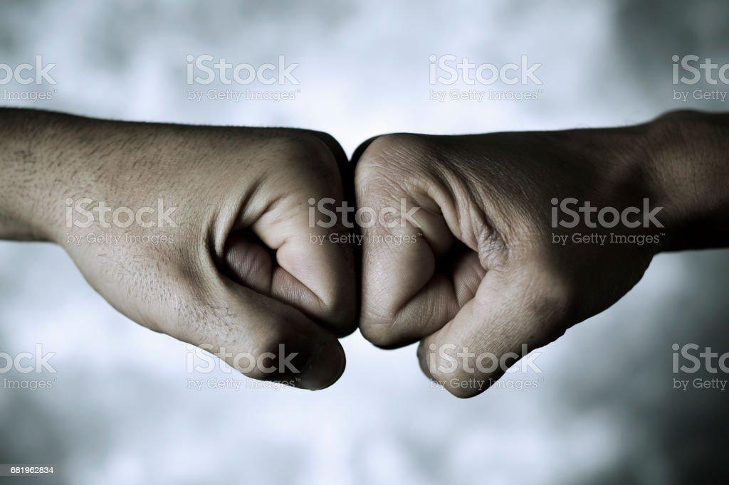 two men fist bumping stock photo