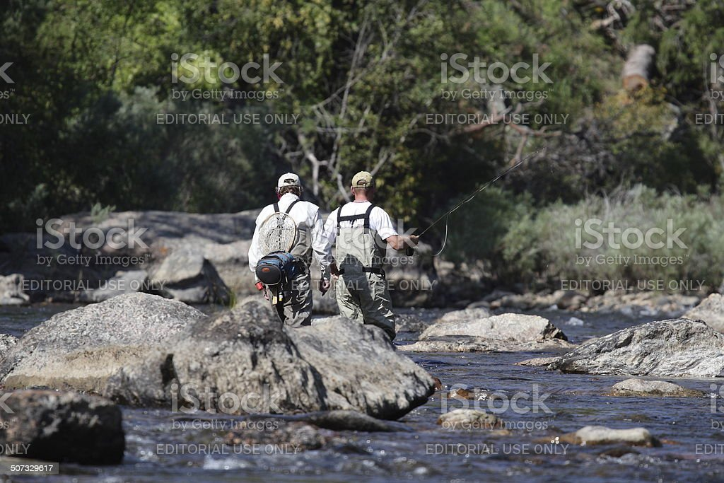 Two Men Fly Fishing in a River royalty-free stock photo