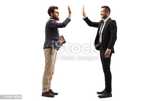 Full length profile shot of two men gesturing high-five isolated on white background