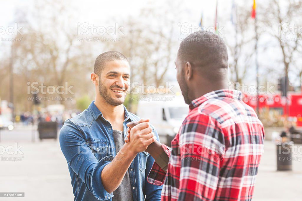 Two men giving a friendly handshake stock photo