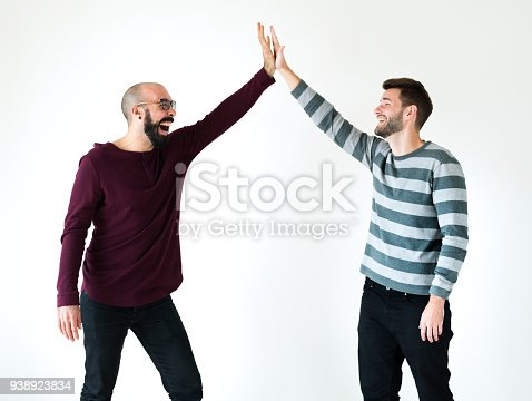 istock Two men giving a high five 938923834