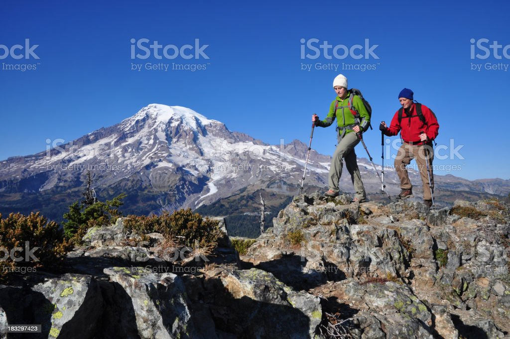 Two men hiking the Mountain Rainier stock photo