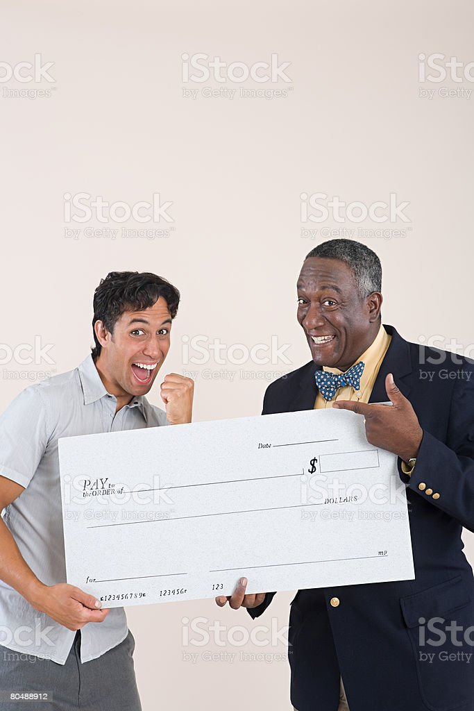 Two men holding a cheque 免版稅 stock photo
