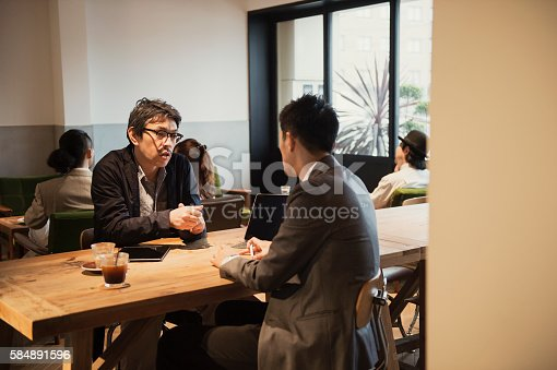 istock Two men in a casual meeting in a Cafe 584891596