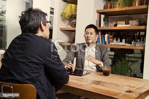 istock Two men in a casual meeting in a Cafe 584892038