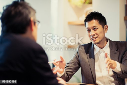 istock Two men in a casual meeting in a Cafe 584892498