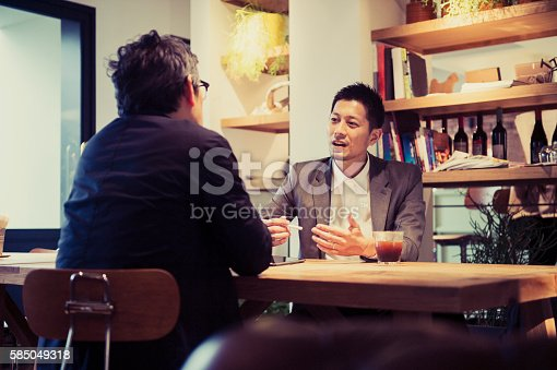 istock Two men in a casual meeting in a Cafe 585049318