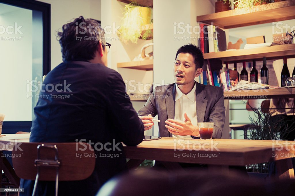 Two men in a casual meeting in a Cafe stock photo