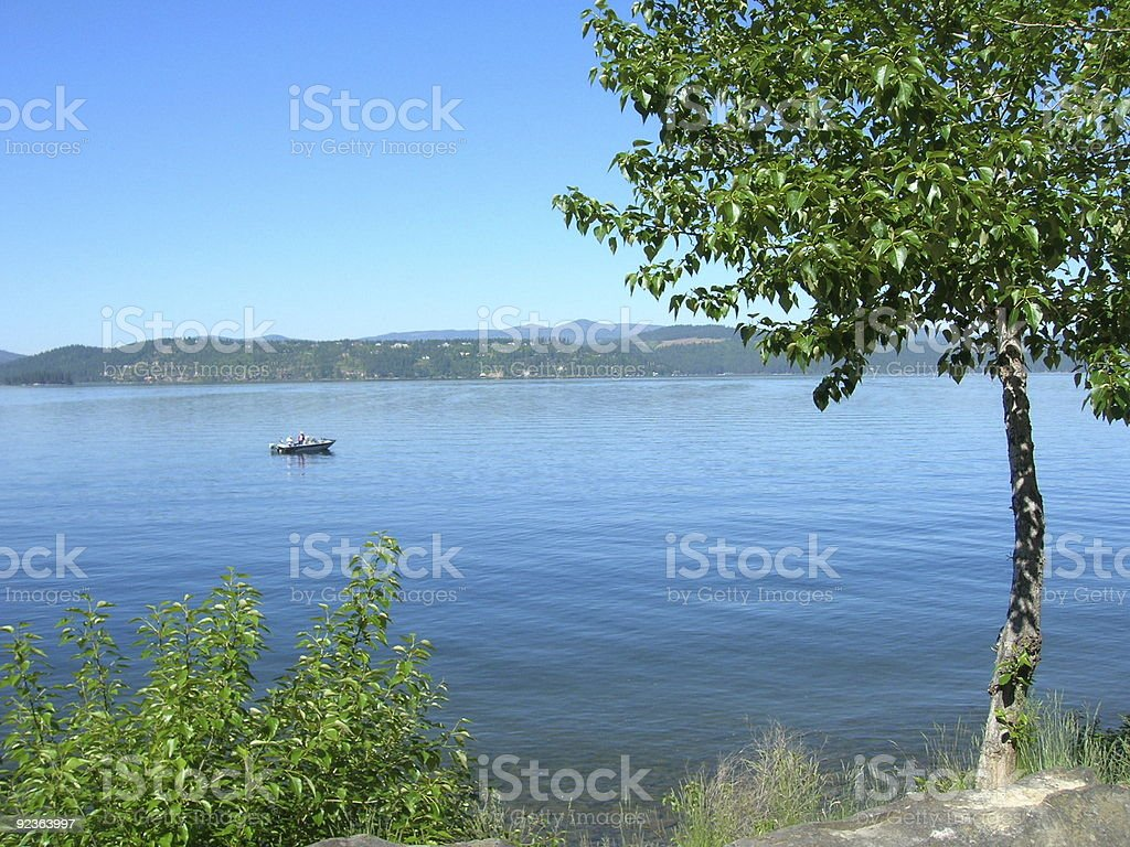 Two men in a Fishing boat stock photo