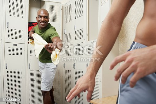 istock Two men in a locker room 520333940