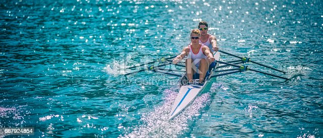 Front view of a coxless pair in a sport rowboat on a lake race, copy space.