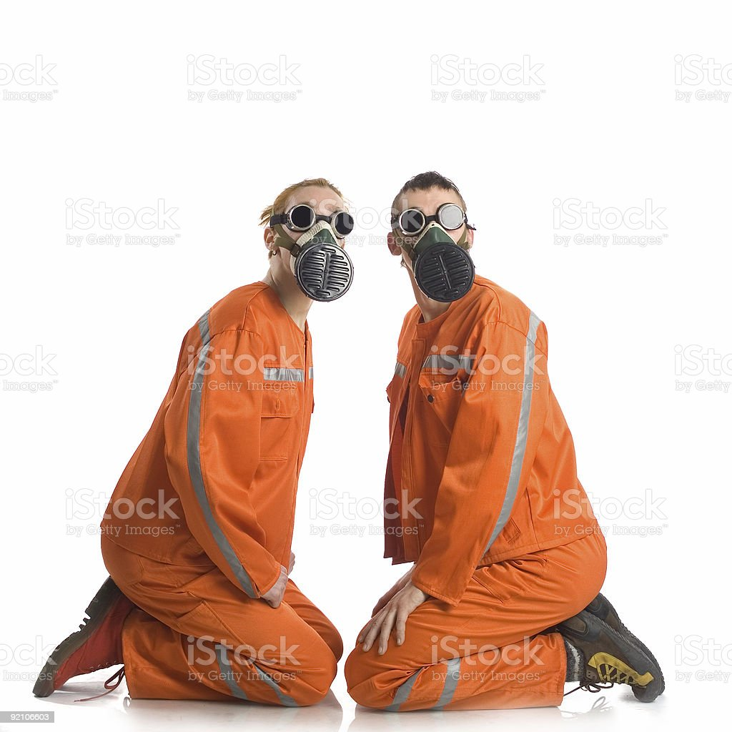 Two men in an orange overalls. stock photo