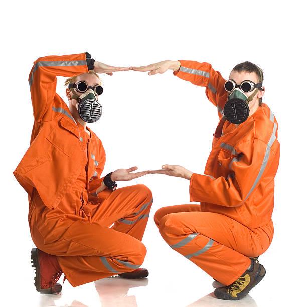 zwei männer in einem orangefarbenen overalls - cro maske stock-fotos und bilder