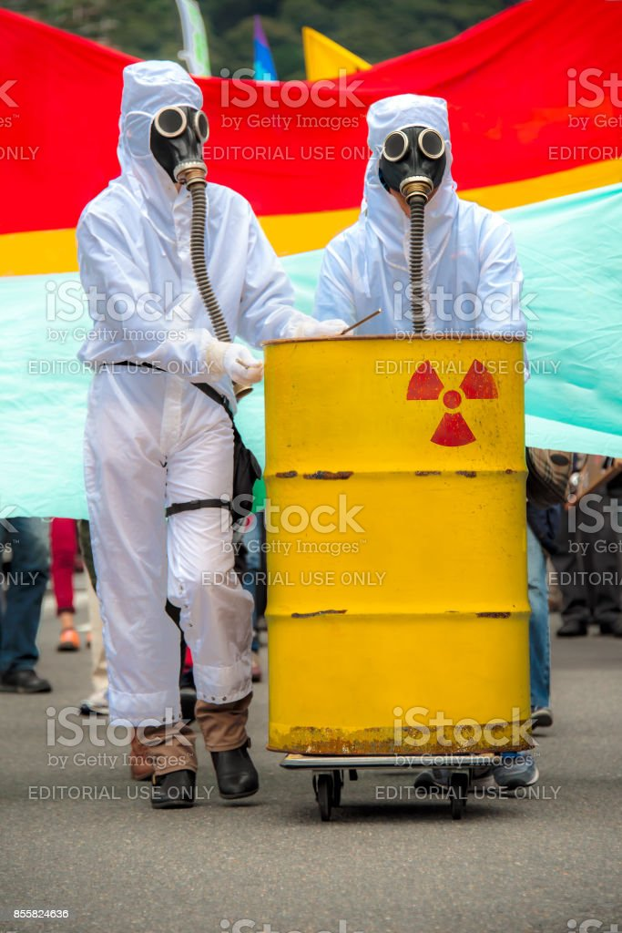 Two men in bio-hazard suits and gas masks. stock photo