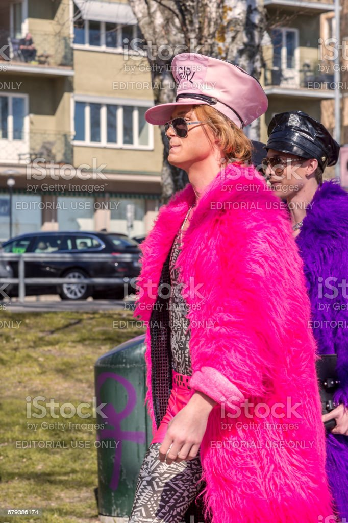 Two men in colorful furs and hats. royalty-free stock photo