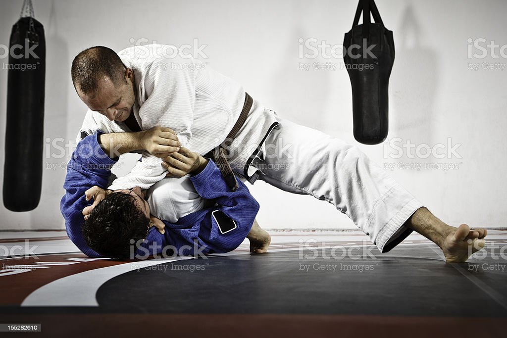 Two Men in Jiu-Jitsu training stock photo