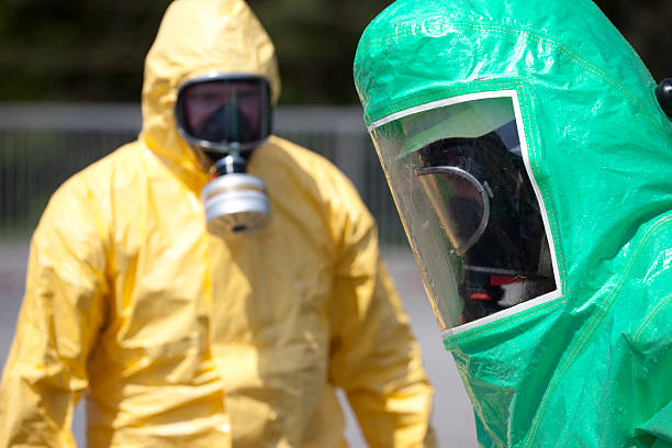 Two men in protective gear stock photo