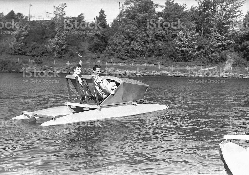 Two men in water pedalo, (B&W) royalty-free stock photo