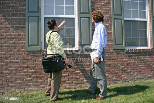 Two men inspecting a home