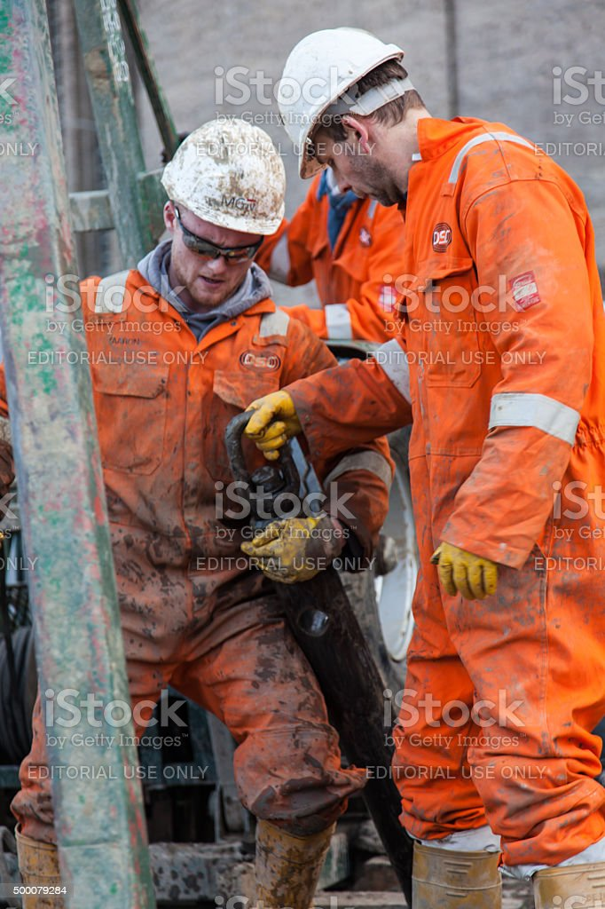 two men is moving the drill stock photo