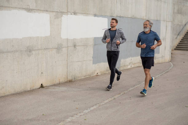 Two Men Jogging Together stock photo