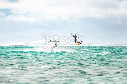 Two men kiteboarding together at Mauritius island