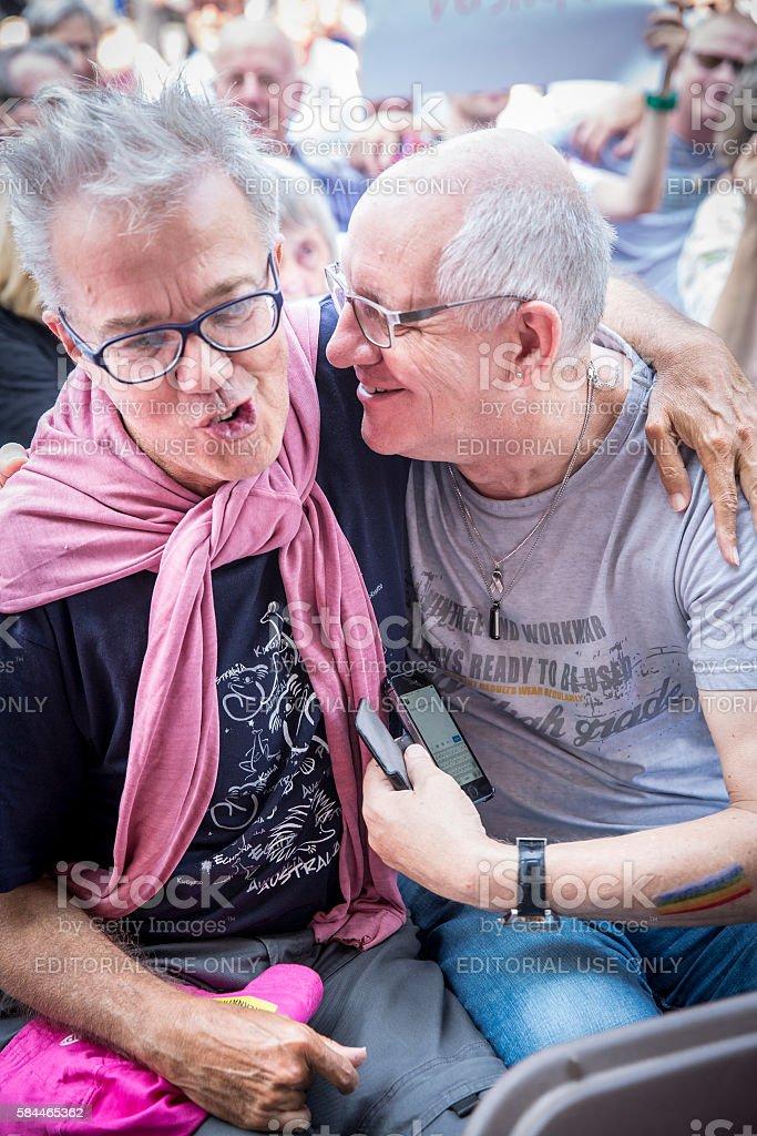 two men laughing Pink Saturday  2016 Gay EuroPride Amsterdam stock photo