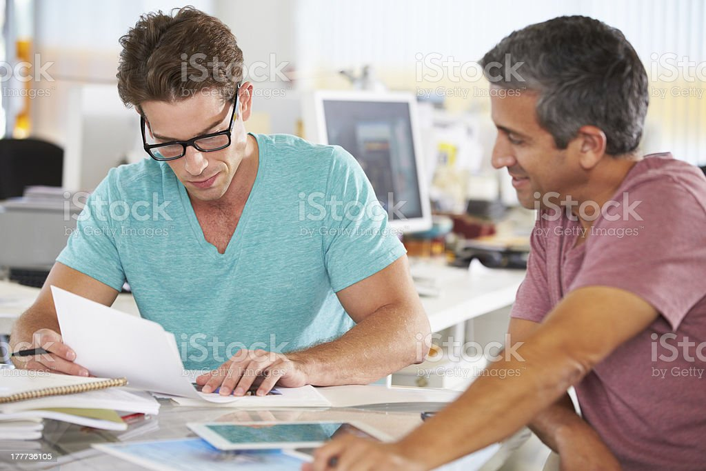 Two Men Meeting In Creative Office royalty-free stock photo