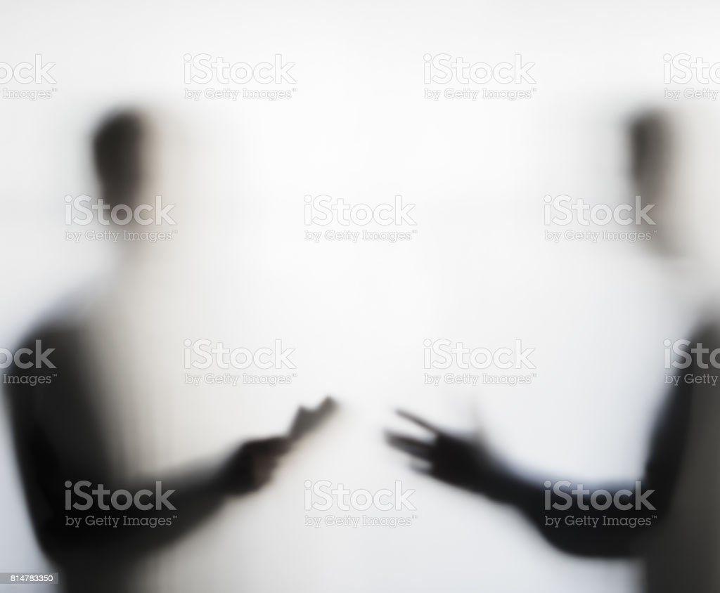 Two men negotiating behind curtain stock photo