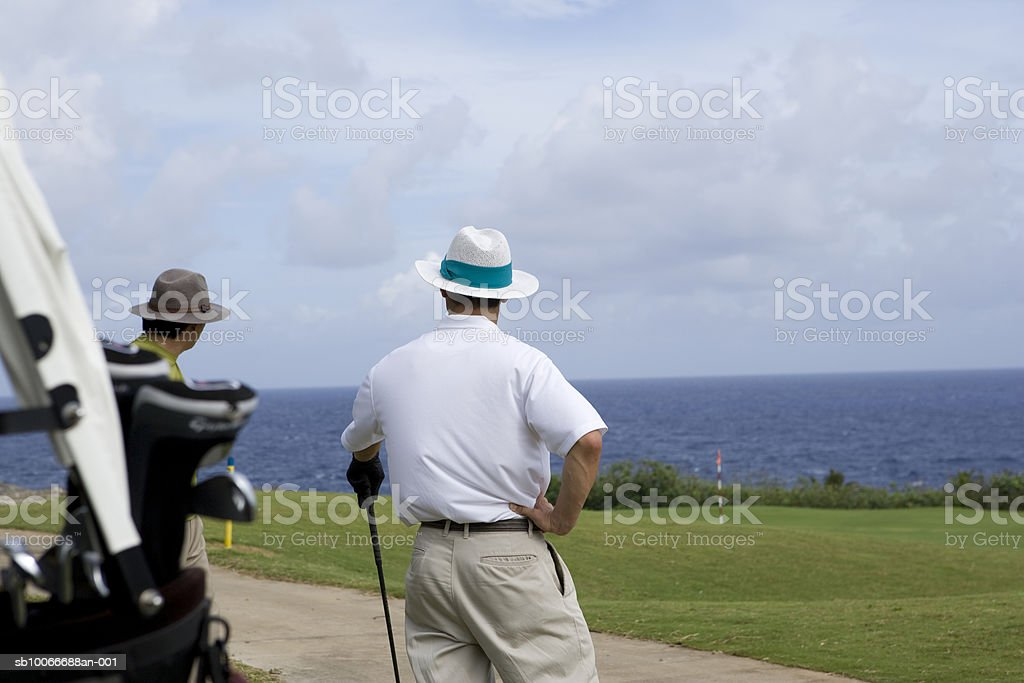 Two men on golf course, looking at view royalty-free stock photo