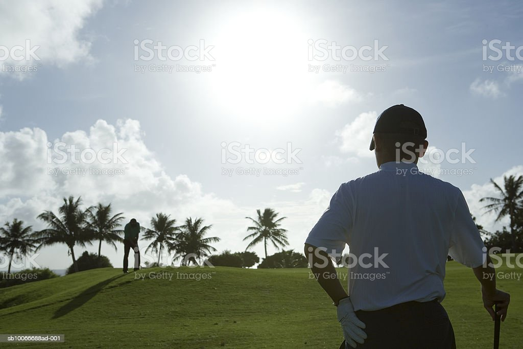 Two men on golf course playing golf 免版稅 stock photo