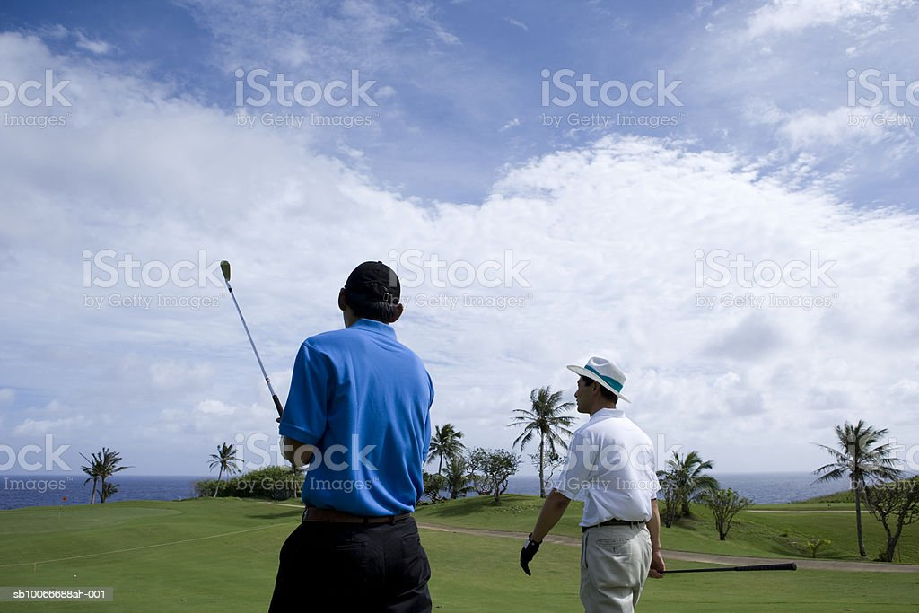 Two men on golf course walking royalty-free stock photo