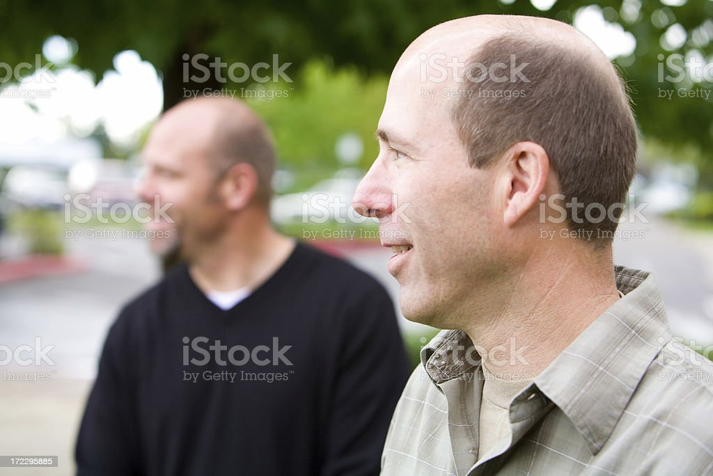 two men outside looking to the side royalty-free stock photo